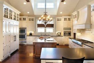 Traditional Kitchen with U-shaped, Glass panel, Chandelier, Soapstone counters, Flat panel cabinets, Exposed beam