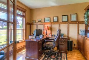 Craftsman Home Office with Standard height, Built-in bookshelf, picture window, Hardwood floors, French doors