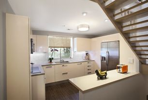 Contemporary Kitchen with Built In Refrigerator, Standard height, can lights, full backsplash, Simple marble counters, Flush