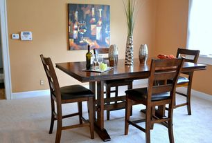 Contemporary Dining Room with Metal vases, Carpet, Painted base boards and framing, Paint, Modern tuscan artwork