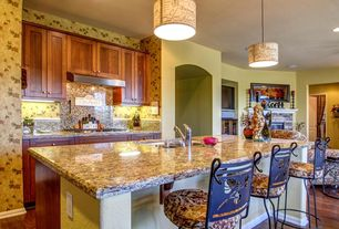 Eclectic Kitchen with flush light, One-wall, Flush, electric cooktop, Flat panel cabinets, Kitchen island, can lights