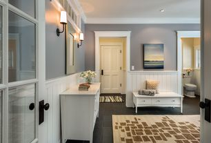Traditional Entryway with Wall sconce, Crown molding, specialty door, Chandelier, soapstone tile floors, French doors