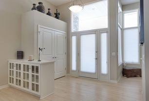 Traditional Entryway with flush light, Built-in bookshelf, French doors, Standard height, Transom window, Hardwood floors