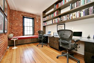 Modern Home Office with Hardwood floors, double-hung window, Standard height, Built-in bookshelf, can lights