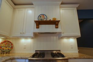 Cottage Kitchen with Wainscotting, Simple granite counters, One-wall, Custom hood, Flat panel cabinets, electric cooktop
