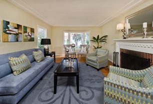 Contemporary Living Room with Crown molding, Hardwood floors, Cement fireplace, Bay window