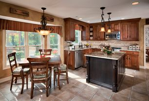 Craftsman Kitchen with Breakfast nook, Daltile porcelain tile - palatina series temple beige, Pendant light, Limestone