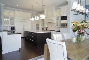 Traditional Great Room with Hardwood floors, Standard height, Pendant light, Crown molding, can lights, Built-in bookshelf