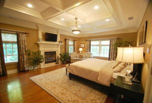 Traditional Master Bedroom with double-hung window, Box ceiling, Standard height, Crown molding, Casement, insert fireplace