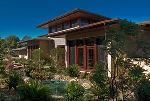 Asian Exterior of Home with Glass door, Pond