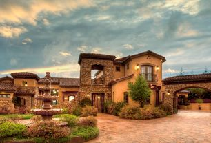 Mediterranean Exterior of Home with Pathway, Clay & Brick  Pavers, Three-Tiered Outdoor Water in Grenoble Pool, Raised beds