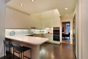Modern Kitchen with Undermount sink, Corian counters, full backsplash, electric cooktop, European Cabinets, Standard height