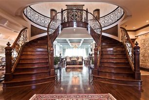 Traditional Staircase with Double staircase, Hardwood floors, Cathedral ceiling