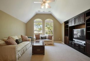 Traditional Living Room with Arched window, Carpet, Built-in bookshelf, Ceiling fan