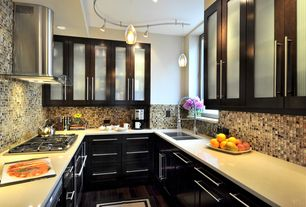 Contemporary Kitchen with Dupont - Corian Linen, Undermount sink, U-shaped, Glass panel, Flat panel cabinets, Pendant light