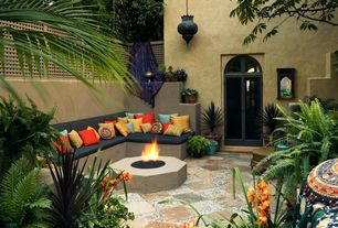 Eclectic Patio with Fire pit, French doors, Fence, exterior stone floors