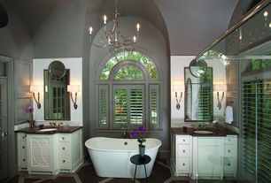 Traditional Master Bathroom with Arched window, Soapstone counters, Cathedral ceiling, specialty tile floors, Freestanding