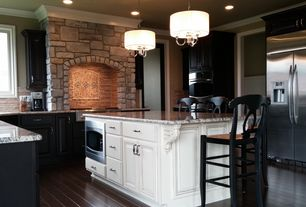 Eclectic Kitchen with picture window, stone fireplace, Fireplace, Chandelier, Standard height, can lights, Hardwood floors