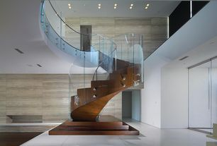 Contemporary Staircase with Hardwood floors, Cathedral ceiling, Spiral staircase