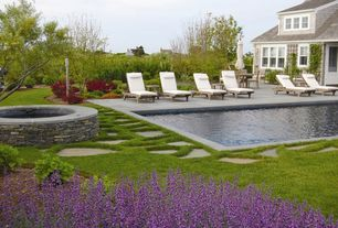 Traditional Swimming Pool with Pathway, Fence, Wood outdoor single chaise lounge, Outdoor seating, exterior stone floors
