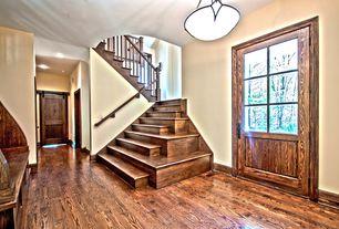 Rustic Entryway with Hardwood floors, Glass panel door, flush light, specialty door, Built-in bookshelf