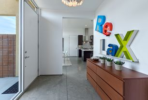 Modern Entryway with Concrete floors, Crate & Barrel Davis Brushed Silver Wall Shelves, Transom window, Chandelier