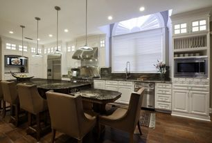 Traditional Kitchen with Complex granite counters, Raised panel, Arched window, Complex Granite, Pendant light, Glass panel