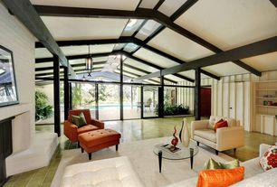 Modern Living Room with Pendant light, Built-in bookshelf, sandstone tile floors, Columns, High ceiling, Exposed beam