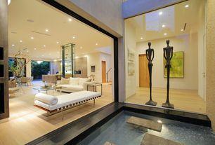 Modern Living Room with Barcelona couch, Laminate floors, Pental Parc Porcelain Tile - Bottocino, Barcelona table