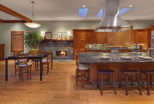 Craftsman Great Room with Laminate floors, Oak - Butterscotch 5 in. Solid Hardwood Wide Plank, Skylight, stone fireplace