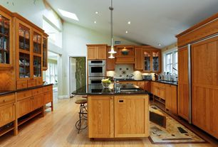 Craftsman Kitchen with Kitchen island, Undermount sink, Custom hood, Soapstone counters, Skylight, Glass panel, U-shaped