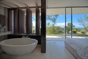 Modern Master Bathroom with Master bathroom, Standard height, Travertino romano round bathtub, Sandstone counters, Bathtub