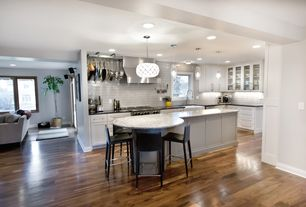 Traditional Kitchen with Standard height, Glass panel, Corian counters, Kitchen island, Flat panel cabinets, Breakfast bar