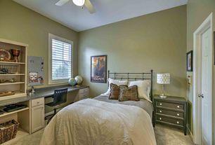 Traditional Kids Bedroom with Standard height, Built-in bookshelf, Ceiling fan, no bedroom feature, Carpet, specialty door