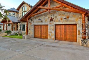 Country Garage with Barn door, Stripped bark truss, High ceiling, Concrete floors, Copper star wall decoration