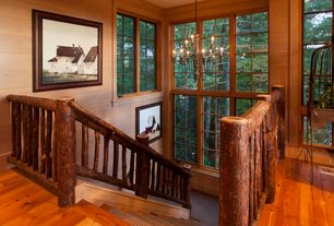 Rustic Staircase with Chandelier, Floating staircase, Hardwood floors, High ceiling, Crown molding