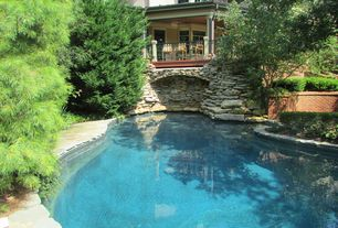 Traditional Swimming Pool with Raised beds, exterior stone floors