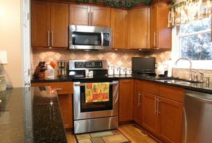 "Craftsman Kitchen with Simple granite counters, Flat panel cabinets, Dynasty Hardware European 6.75"" Bar Pull, Stone Tile"