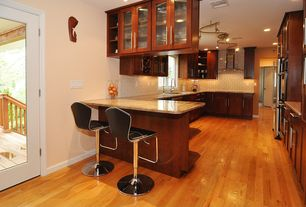 Contemporary Kitchen with U-shaped, Glass panel, Maple - Cinnamon 2 1/4 in. Solid Hardwood Strip, Flush, Breakfast bar