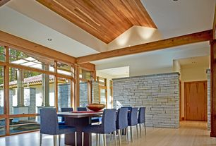 Contemporary Dining Room with flat door, can lights, Laminate floors, Exposed beam, picture window, High ceiling