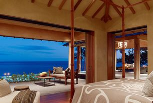 Master Bedroom with Outdoor seating, Columns, Pendant light, Indoor/outdoor living, Laminate floors, Cathedral ceiling