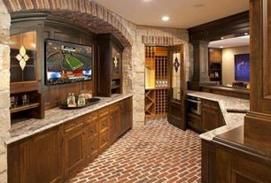 Craftsman Wine Cellar with Built-in bookshelf, Brick floors, Glass panel door