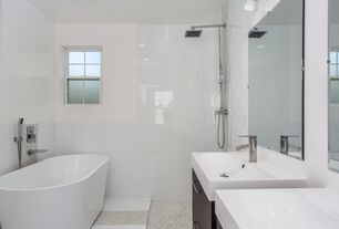 Contemporary Full Bathroom with Handheld showerhead, limestone tile floors, European Cabinets, Flush, Rain shower