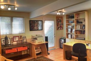 Traditional Home Office with Built-in bookshelf, French doors, terracotta tile floors, flush light