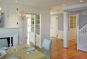Traditional Dining Room with Standard height, can lights, Cement fireplace, Columns, specialty door, Built-in bookshelf