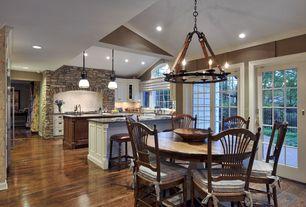 Rustic Kitchen with Flat panel cabinets, Kitchen island, Breakfast nook, full backsplash, French doors, Glass panel, U-shaped