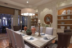 Traditional Dining Room with Built-in bookshelf, flush light, Crown molding, French doors