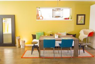 Eclectic Dining Room with Pendant light, Hardwood floors