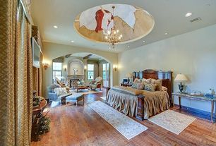 Traditional Master Bedroom with Built-in bookshelf, Wall sconce, Hardwood floors