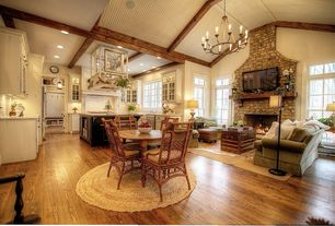 Country Great Room with High ceiling, Chandelier, stone fireplace, Exposed beam, Hardwood floors, Built-in bookshelf